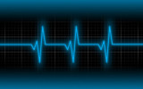 Electrocardiogram - Concept of healthcare heartbeat shown on monitor - blue