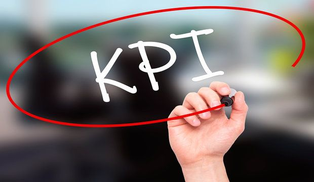 Man Hand writing KPI (Key Performance Indicator) with black marker on visual screen. Isolated on background. Business technology internet concept. Stock Photo