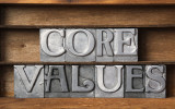 core values phrase made from metallic letterpress type on wooden tray