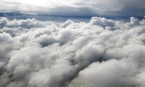 Above the clouds in the sky. View from above the clouds. Flying over clouds in plane. Space boundless. Weather and climate. Big clouds. Atmosphere and stratosphere. Meteorology and aircraft.
