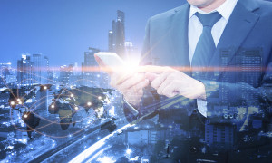 Double exposure of professional businessman using cloud technology in smart phone with servers technology in data center and network connection in IT Business technology concept world map from NASA