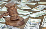 Financial Crime or Fraud or Auction Concept Image With Judges Gavel or Auction Hammer And Money Stack On The Background Close Up