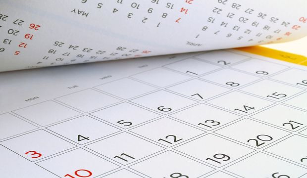 desk calendar with days and dates in July 2016, flip the calendar page