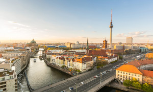 Berlin aerial view at sunset. Berlin Cathedral on the left tv tower on the right. Golden light over Berlin rooftops in the late afternoon. Travel and architecture concepts