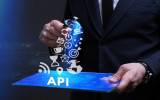 Business Technology Internet and network concept. Young businessman working on a virtual screen of the future and sees the inscription: API