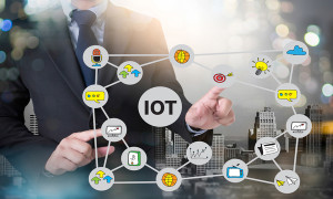 IOT business man hand working and internet of things (IoT) word diagram as concept and businessman working with modern technology