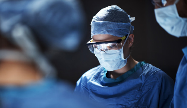 Cropped shot of surgeons performing a surgical procedure