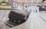 baggage claim area in the airport, abstract luggage line  with many suitcases