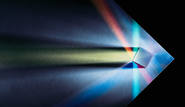 Prism Multi-colored Refraction on the Edge of White Paper, Directly Above View.