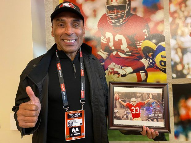 Roger Craig shows off his 2020 NFL Hall of Fame Nominee plaque in the TIBCO suite at Levi's stadium, home of the San Francisco 49ers
